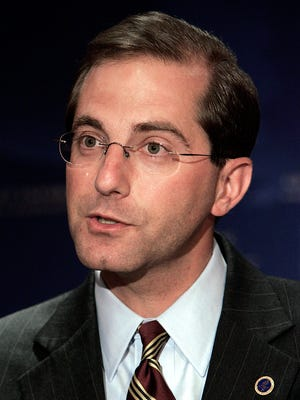 Alex Azar II, then the deputy secretary of Health and Human Services in the George W. Bush administration, speaks at a Michigan pandemic influenza summit in Detroit in 2006.