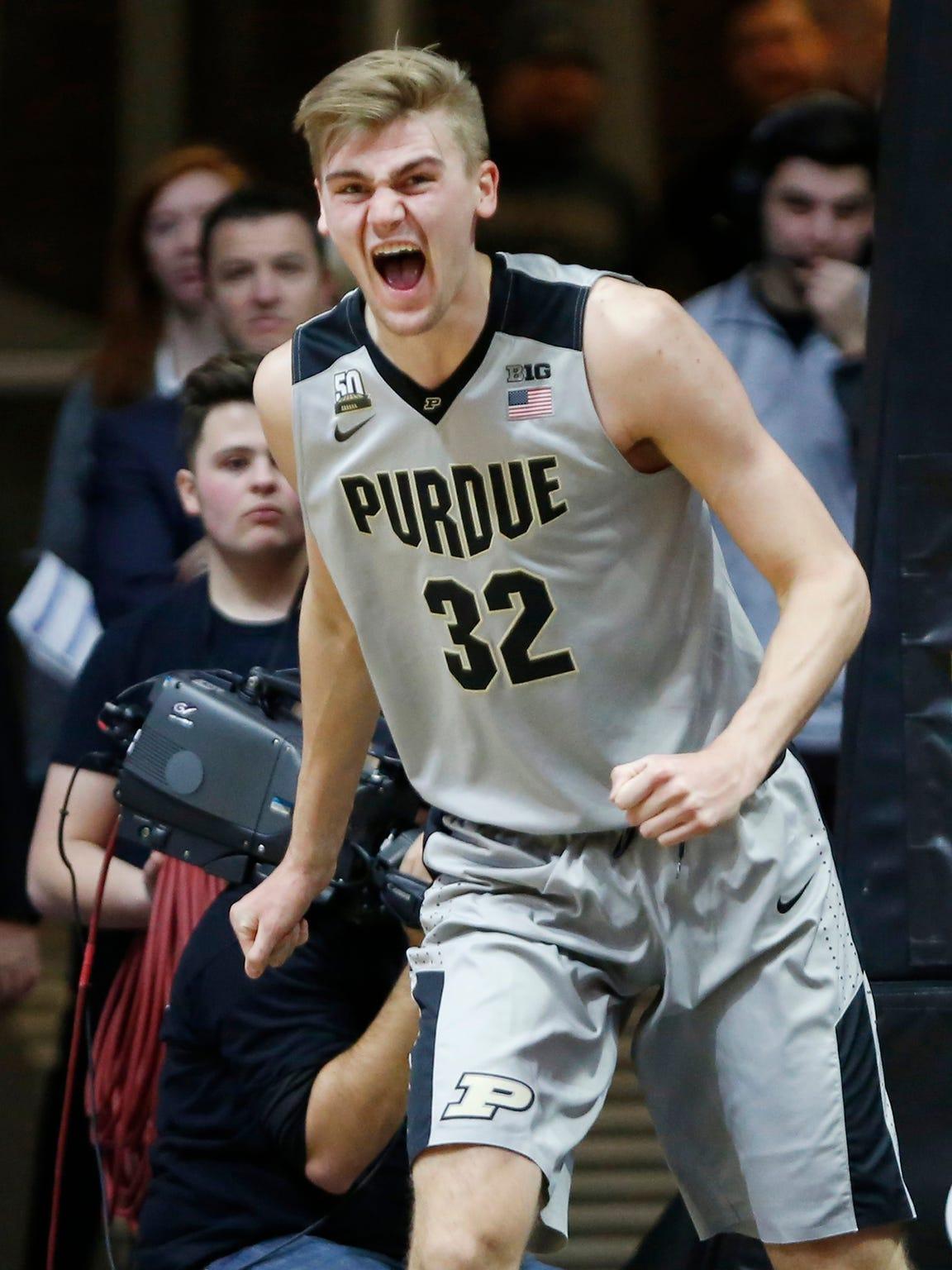 Matt Haarms of Purdue reacts after blocking a shot