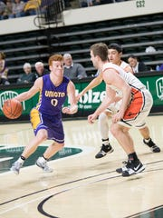 Unioto's Logan Swackhammer looks to drive past two Waverly defenders at Ohio University's Convocation Center during a Division II district championship in 2018.