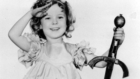 "In this 1933 file photo, child actress Shirley Temple is seen in her role as ""Little Miss Marker."" Shirley Temple, the curly-haired child star who put smiles on the faces of Depression-era moviegoers, has died. She was 85. Publicist Cheryl Kagan says Temple, known in private life as Shirley Temple Black, died Monday night, Feb. 10, 2014, surrounded by family at her home near San Francisco."