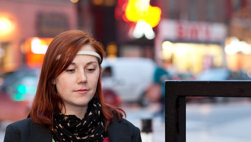 A woman wears the Muse brain sensing headband.