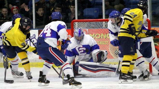 Catholic Central goaltender Spencer Wright (middle) made 20 saves in the 6-0 shutout of No. 2-ranked Rochester United.