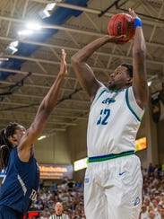 Senior center Antravious Simmons and his FGCU frontline