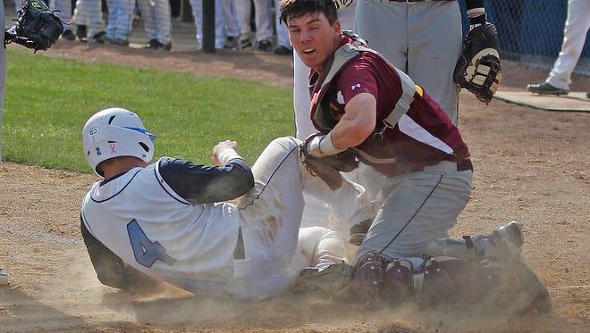 Boone County High School baserunner Cameron Faehr is safe at home in front of Cooper High School catcher Burton Tienken on Monday.