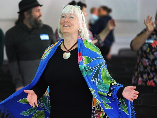 Susan Soleil participates prior to speaking during Sunday Assembly in Salt Lake City on Sunday, Feb. 11, 2018. Sunday Assembly is a nonprofit group designed to serve atheists, agnostics, humanists and other religiously affiliated adults in Utah.