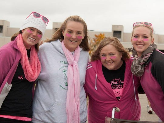 Community members sport their pink outfits while participating