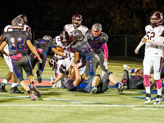 A wall of Madison defenders stops an Owen run at the