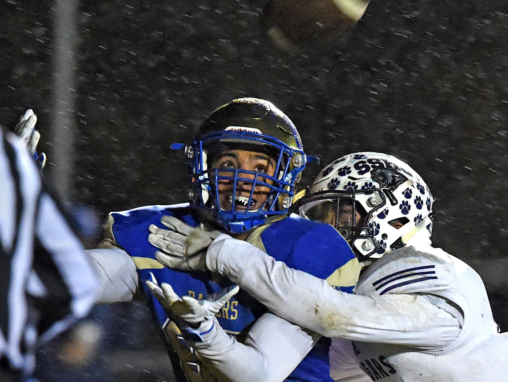 Reed's Michael Spivack makes a catch near the end zone and holds on to the ball for a toughdown as Spanish Springs' Colton Allen tackles him eary in the first quarter on Oct. 27