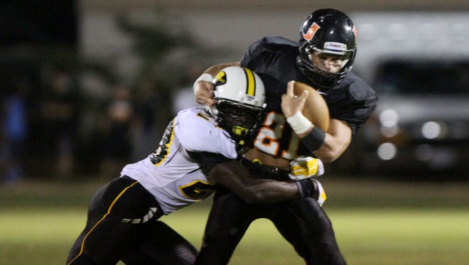 Union Parish running back Jacob Fossier (21) drags Haynesville defender James Jackson (23) for a few more yards on the play during the second quarter.