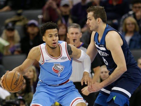Sacramento Kings forward Skal Labissiere, left, goes to the basket against Minnesota Timberwolves forward Nemanja Bjelica during the first quarter of an NBA basketball game Monday, Feb. 26, 2018, in Sacramento, Calif. The Timberwolves won 118-100. (AP Photo/Rich Pedroncelli)