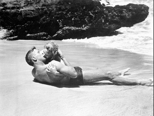 """Burt Lancaster and Deborah Kerr are shown in this passionate scene from the 1953 movie """"From Here to Eternity."""""""