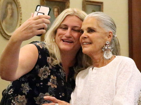 Melanie Fatuesi takes a selfie with Ali MacGraw during an autograph signing event Aug. 4 at the El Paso Community Foundation Room at 333 N. Oregon St.