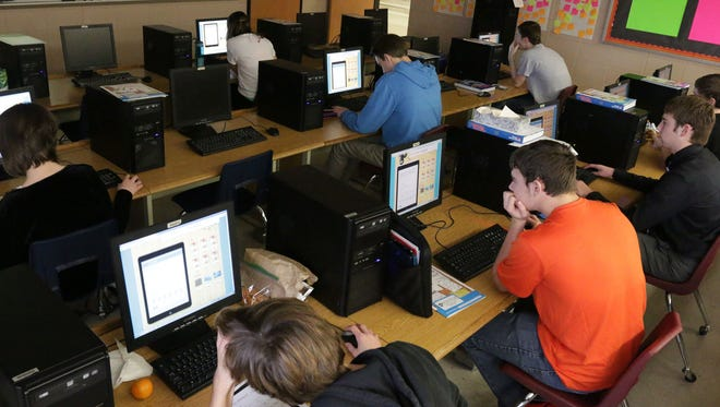 Students work on Bonzai, a personal finance program, at Plymouth High School.
