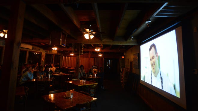 """Island House Restaurant Executive Chef Michael Kane is shown during an episode of Food Network's """"Beach Eats USA"""" on Wednesday during a viewing party at the Wachapreague restaurant."""