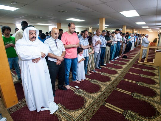 Congregants stand during prayers at the Islamic Society