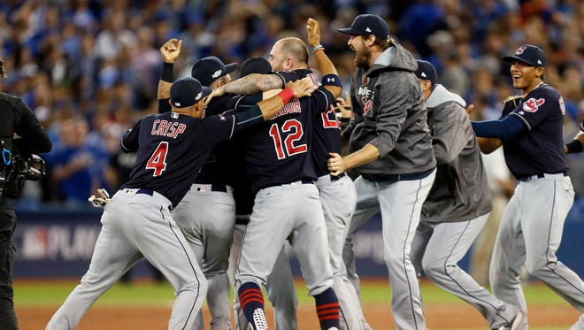 The Indians celebrate beating the Blue Jays to advance to the World Series.