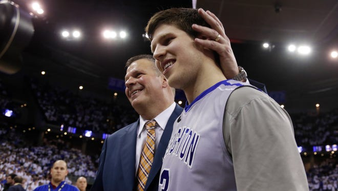 Creighton coach Greg McDermott and his son, Doug McDermott (3), March 8, 2014 after Doug scored a career-high 45 points and became the eighth player in Division I history to go over 3,000 for a career, as Creighton rolled to an 88-73 victory over Providence.