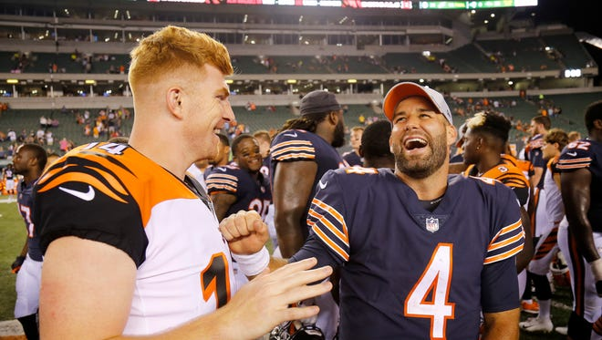 Cincinnati Bengals quarterback Andy Dalton (14) and Chicago Bears quarterback Chase Daniel (4) laugh as they shake hands after the fourth quarter of the NFL Preseason Game One between the Cincinnati Bengals and the Chicago Bears at Paul Brown Stadium in downtown Cincinnati on Thursday, Aug. 9, 2018. The Bengals won the pre-season opener, 30-27.