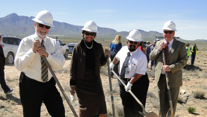 Doña Ana County Commissioner Wayne Hancock, County Manager Julia Brown, County Commissioner David Garcia, and Patrick Peck, executive director of the South Central Solid Waste Authority break ground at the Chaparral Collection and Recycling Center.