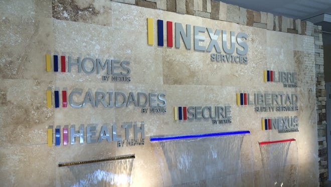 Pictured is a wall with waterfalls inside the Verona offices of Nexus Services Inc.