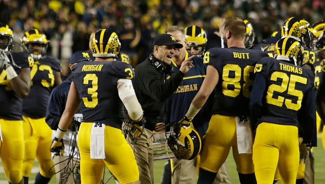 Michigan coach Jim Harbaugh directs his team during the second half Saturday in Ann Arbor.