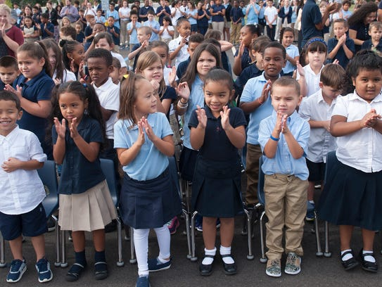 First-grade students clap during the ribbon-cutting