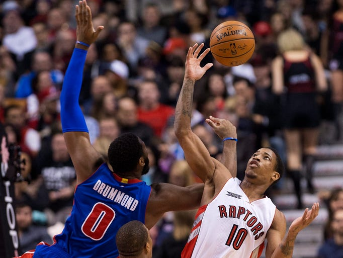 Raptors forward DeMar DeRozan battles for the ball
