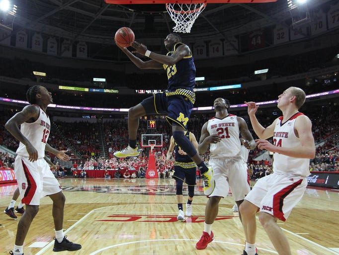 Michigan's Caris LeVert (23) makes a basket in the