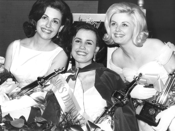 Claudia Sand, center, was crowned the winner of the