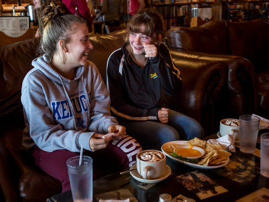 Sylar Redden, 13, looks over to her friend Natalie Napier, 13, as they laugh and cry together while having lunch with Michelle Redden, 33, Wednesday, September 14, 2016 at The Raven Cafe in Port Huron. Michelle was previously in partial remission from cervical cancer, but received a terminal diagnosis in August.