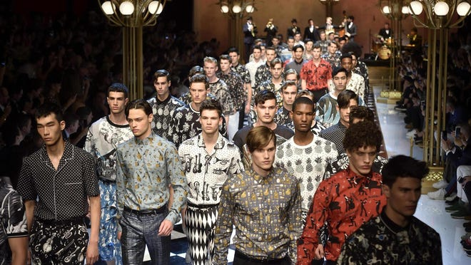 Dolce&Gabbana invited the crowd to a Sicilian jazz festival with echoes of New Orleans and the Copa Cabana resounding along the checkerboard runway in Milan.