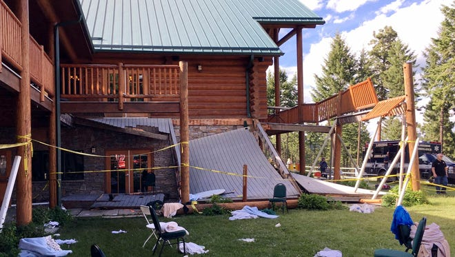 In this image taken Saturday, June 17, 2017, debris is strewn about at the scene where a second-story deck collapsed at a lodge near Lakeside, Mont. Authorities now say more than 30 people were taken to hospitals after the second-story deck of a Montana lodge collapsed during a memorial event for a firefighter. About 50 people were gathered to remember William Nickel, a longtime Flathead Valley firefighter who died in April. (Firefighter/Engineer Mathew Borlandelli/Somers/Lakeside Fire Department via AP)