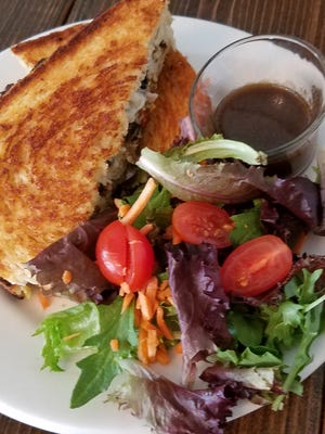 The Rabbits Veggies Pannini is a veggie burger and salad, ideal for a light lunch.