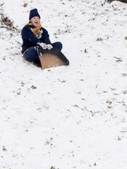 Amanda Cherry sleds down a hill at Betty Virginia Park