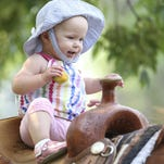 Emelia Moon, 1, enjoys her time in the saddle at Saddles & Spurs two years ago. This year's event takes place Saturday at the C.M. Russell Museum.