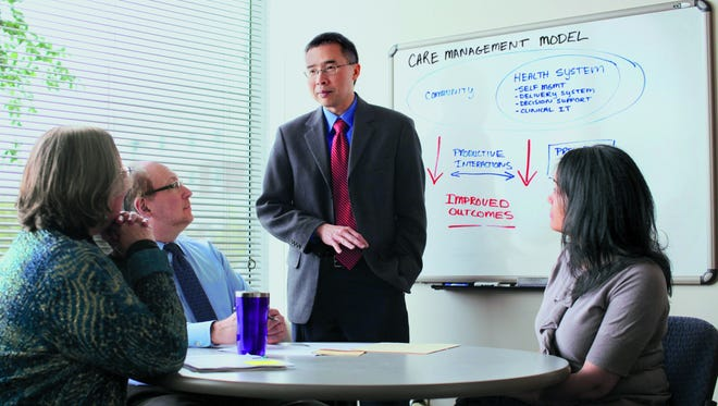 Henry Chung, medical director of the Montefiore Accountable Care Organization, explains the CMO model to colleagues.