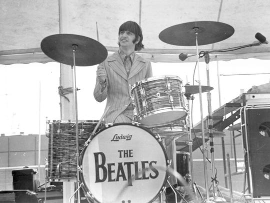 Ringo Starr of the Beatles performs at Crosley Field.