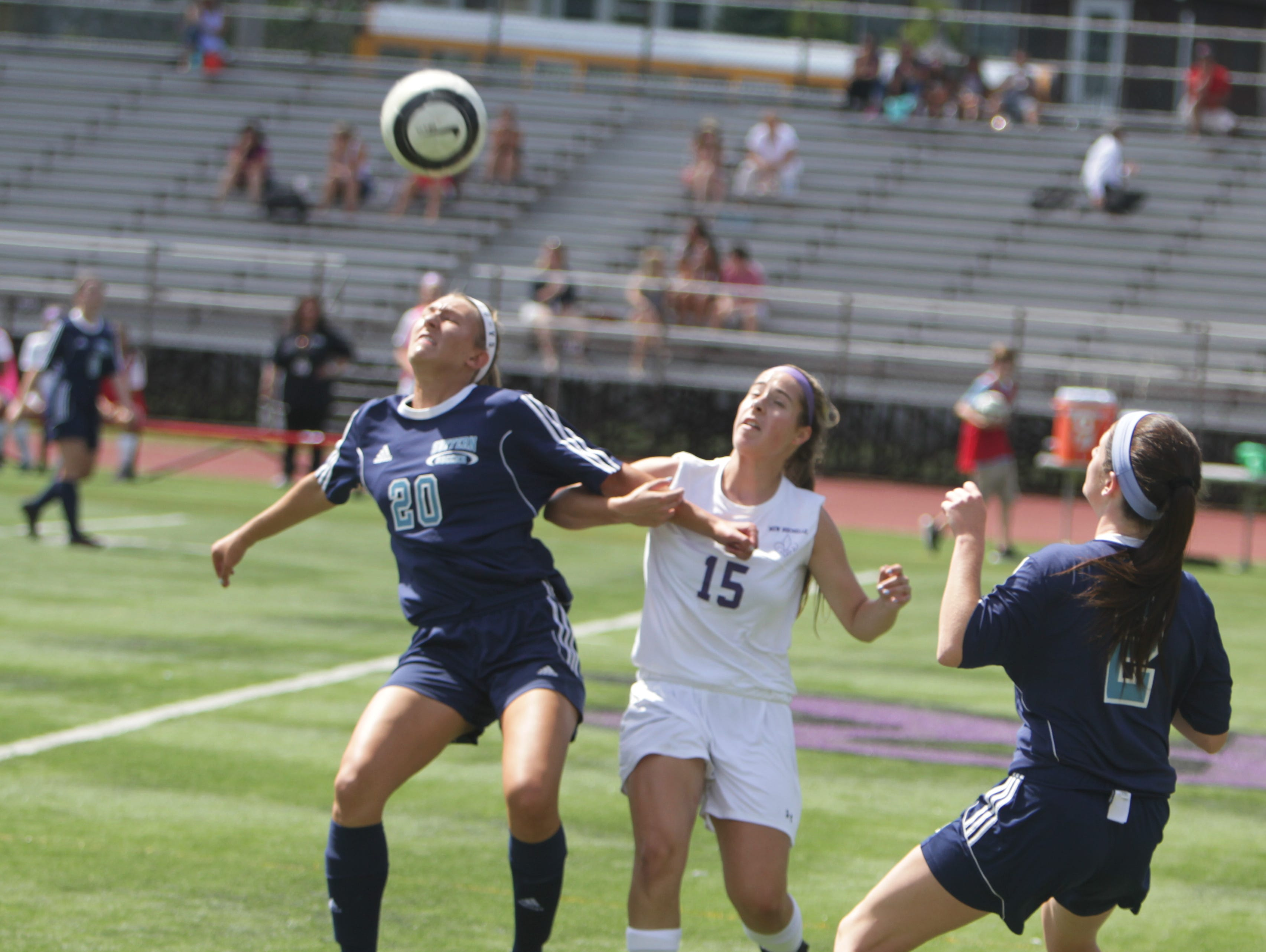Suffern's Jayne Goldman (20) and New Rochelle's Sophie Wolf (15) fight for a ball in the air during a Section 1 girls soccer game between New Rochelle and Suffern at New Rochelle High School Friday, Sept. 2. Suffern won 4-1.