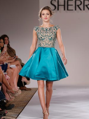 Sadie Robertson walks the runway at the Sherri Hill fashion show during Mercedes-Benz Fashion Week Fall 2015 at The Plaza on Feb. 19 in New York.