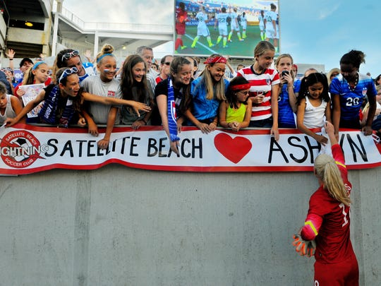 Satellite Beach graduate #18 Ashlyn Harris of U.S. Women's National soccer team signs autographes for her hometown fans at the Citrus Bowl Sunday afternoon after US women's soccer team beat Brazil, the U.S. women's National team are fresh off their World Cup victory .