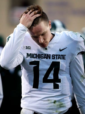 Michigan State quarterback Brian Lewerke reacts on the sideline in the second half against Northwestern in Evanston, Ill., Saturday, Oct. 28, 2017.