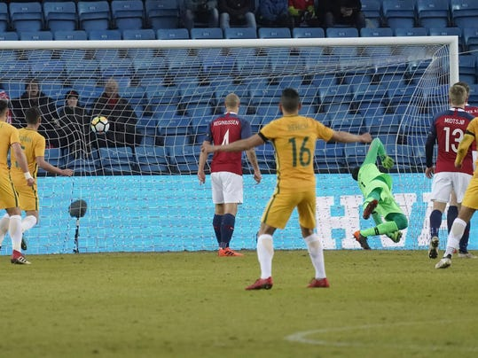 Jackson Irvine of Australia scores the first goal of their friendly soccer match against Norway, in Oslo, Norway, Friday March 23, 2018. (Cornelius Poppe/NTB scanpix via AP)