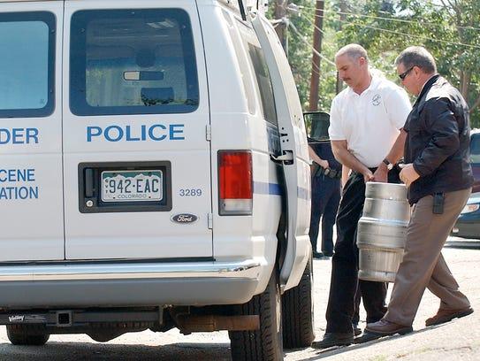 Boulder, Colorado, Police investigators remove one