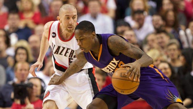 Mar 30, 2015: Portland Trail Blazers guard Steve Blake (5) defends Phoenix Suns guard Archie Goodwin (20) at Moda Center at the Rose Quarter.