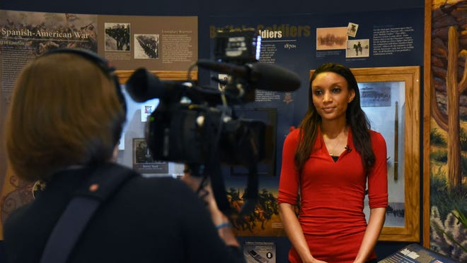 C-SPAN producer Adrienne Hoar records African American Military History Museum manager Latoya Norman in the Hattiesburg museum.
