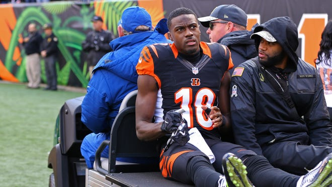 Bengals wide receiver A.J. Green is carted off the field after being injured in the first half against the Bills at Paul Brown Stadium.