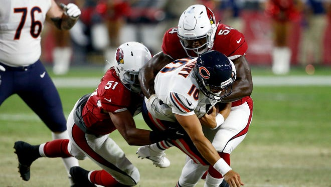 Chicago Bears quarterback Mitchell Trubisky (10) is sacked by Arizona Cardinals linebacker Alex Bazzie, right, and linebacker Tre'Von Johnson (51) during the second half of a preseason NFL football game, Saturday, Aug. 19, 2017, in Glendale, Ariz.