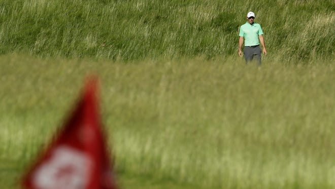 Rory Mcilroy, of Ireland, makes his way to the 12th hole during the first round of the U.S. Open golf tournament Thursday, June 15, 2017, at Erin Hills in Erin, Wis.