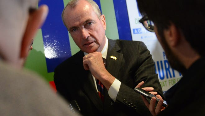 Gubernatorial candidate Phil Murphy speaks with the press at the Murphy for Governor Field Office in Newark on Jan. 9, 2017.