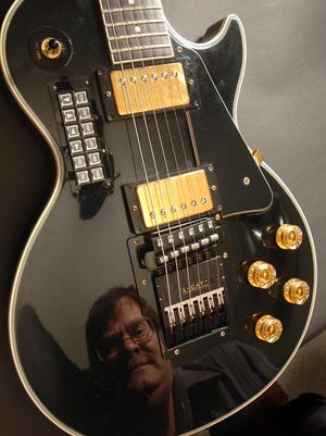 Neil Skinn, founder of AxCent Tuning Sytems is seen in the reflection of his Gibson Les Paul Standard guitar in 2007. A new Crowdfunder campaign for the company is aimed at bringing self-tuning guitar technology to the masses.